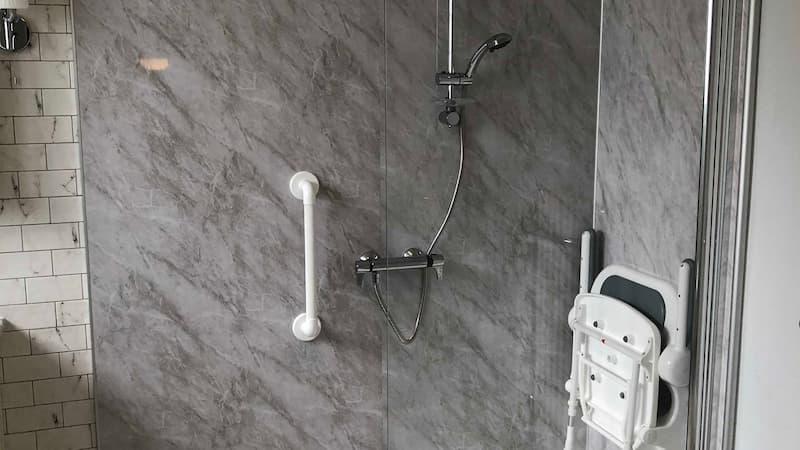 shower-foldable seat- assisted handles - tiling - disabled shower