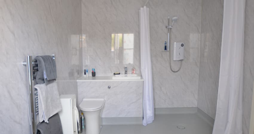walk in shower-curtain- aided shower